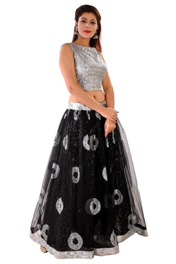 93b09c1ce7462e This black and silver crop top style lehenga is done in georgette and net.  The Choli is completely embellished in sequins and the skirt is adorned  with ...