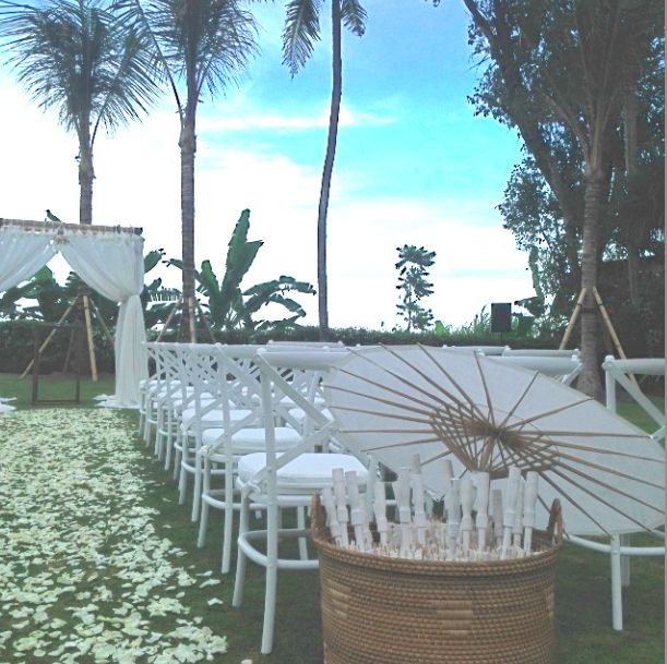 Sweet and simple ceremony set up with our White Crossback Chairs | Bali Event Hire www.balieventhire.com