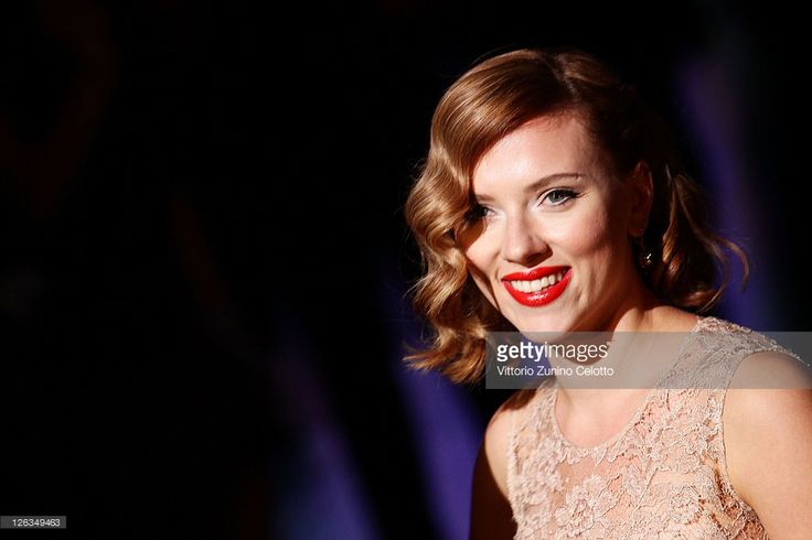 Actress Scarlett Johansson attends the Dolce & Gabbana Spring/Summer 2012 fashion show as part Milan Womenswear Fashion Week on September 25, 2011 in Milan, Italy.