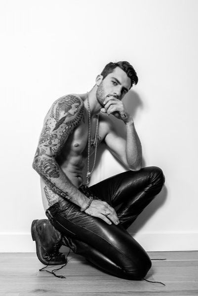 Tattooed Guys In Leather Clothes Making Out