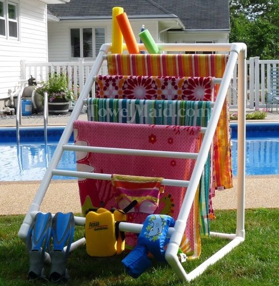 Pool Organization Ideas tame pool noodles and floats by adding baskets to your garage organization system organizedliving How To Build A Pvc Pool Towel Rack