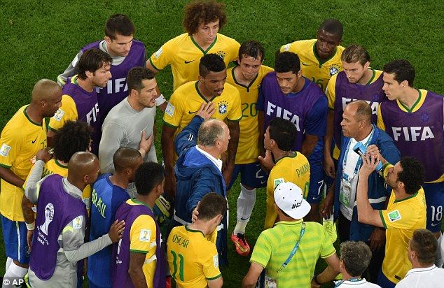 Luiz Felipe Scolari talks to his players after the devastating defeat