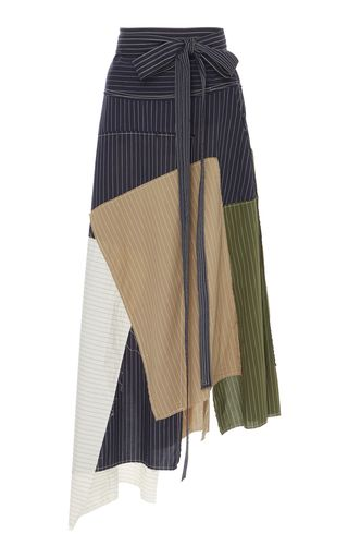 JW Anderson's skirt is crafted from panels of striped cotton to create a cool patchwork effect. Fitted with ties to nip in your waist, this style has a fluid asymmetric hem. Wear yours with a tucked-in tee and sandals.
