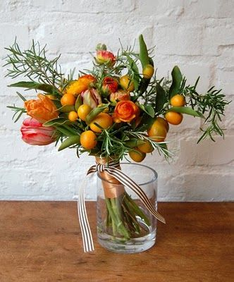 love the use of fruits in flower arrangements.    Rosemary and citrus bouquet by Studio Choo