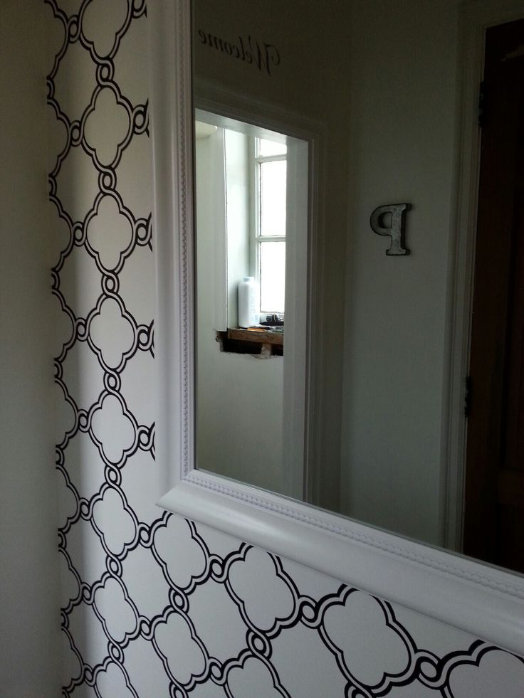 My new front hallway wallpaper.  I did it myself! Phil helped me with hanging things on the walls.