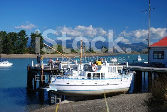 Boat & Tourists on Mapua Wharf, Tasman Region, New Zealand royalty-free stock photo