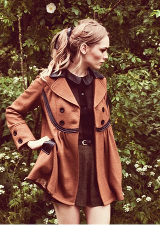leather collar and details on a wool coat