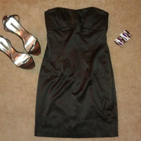 *PAYDAY SALE* Strapless fitted black dress Strapless fitted black dress.  Satin-like finish. Perfect for cocktails or a night out. I love love love this dress,  but I've put on a little weight and can no longer comfortably fit it.  Only worn once to a wedding. Bundle dress and bracelet for extra savings. Forever 21 Dresses