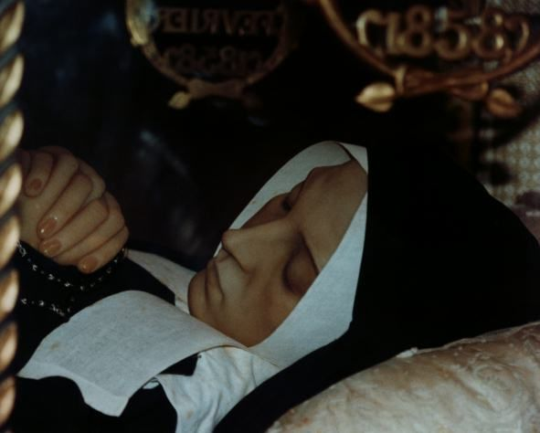 St. Bernadette....This is a photo of her.  She is encased in a glass casket in France.
