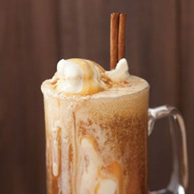 Apple Cider Float: 2 cups apple cider, 1 cinnamon stick, 1 cup vanilla ice cream, 1 tbsp. caramel sauce, grated nutmeg.