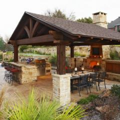 I'd like a slightly scaled down, less elaborate 'outdoor living area' like this on opposite side of pool from the house...not a kitchen, just outdoor fireplace with covered seating area...