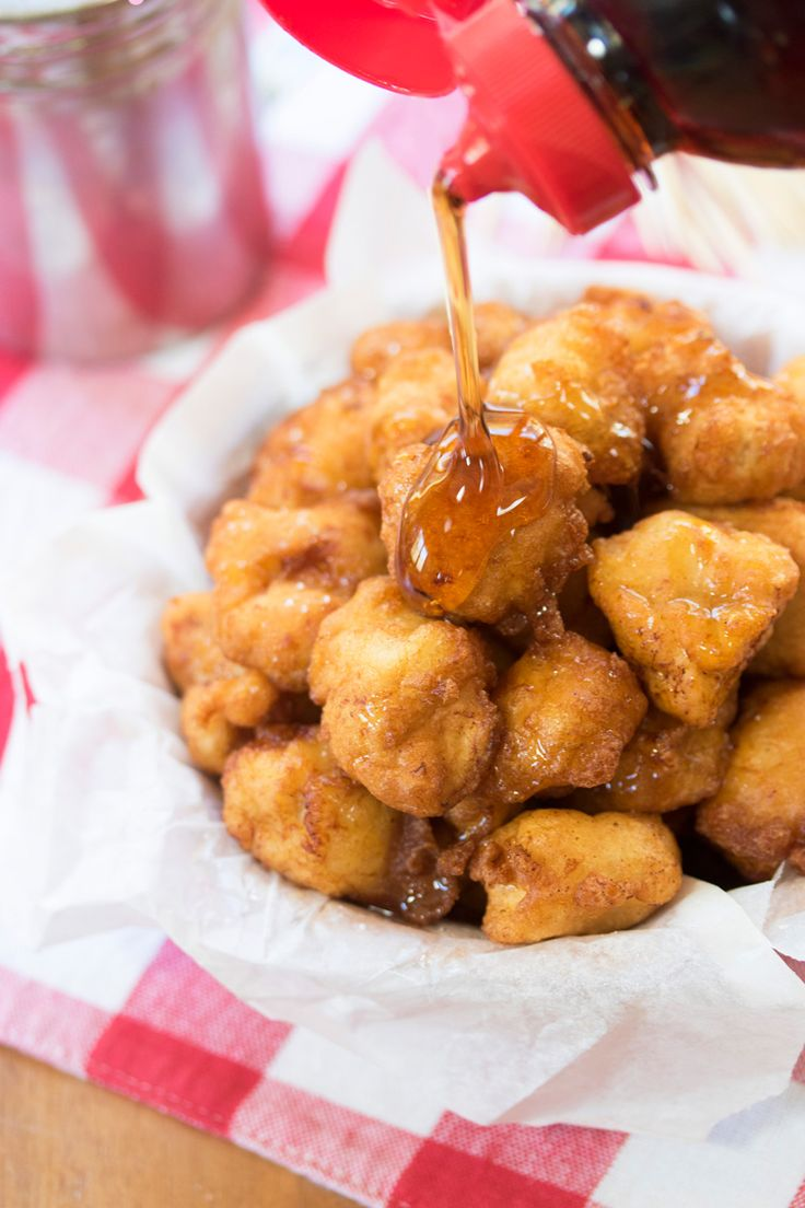 Savory chicken bites are sprinkled with cinnamon & sugar, submerged in decadent pancake batter, and fried to golden perfection.