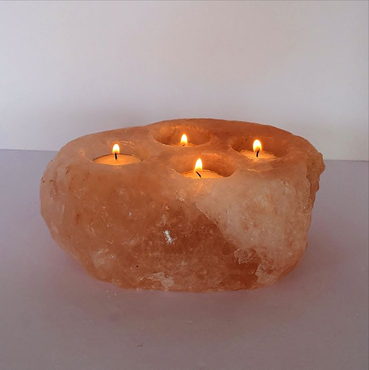 Our popular natural cut/ hand carved Pink Himalayan Salt Rocks with four holes to place your favorite candles or lights. Makes any space special. These remarkable little tea lights, when lit, will cre