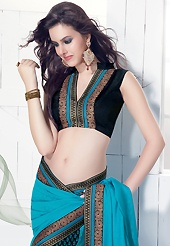 A desire that evokes a sense of belonging with a striking details. This blue and black faux crepe saree is nicely designed with floral print and embroidered patch work is done with resham, zari and sequins work. This saree gives you a modern and different look in fabulous style. Matching black blouse is available. Slight color variations are possible due to differing screen and photograph resolution.