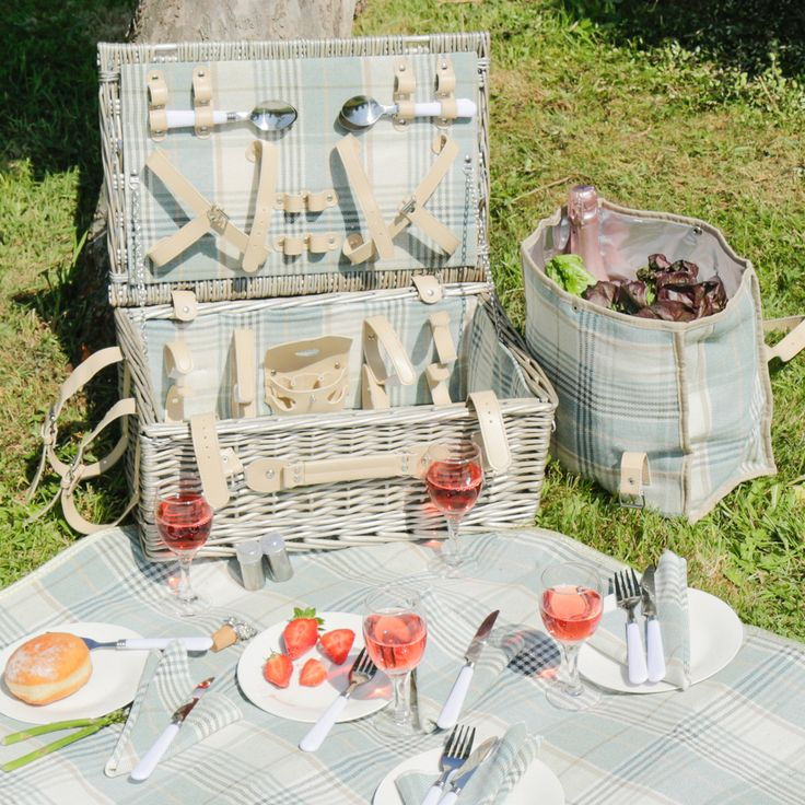 Take a look at our exquisite range of traditional picnic baskets. This Sky Blue and Clotted Cream Tartan 4 Person Picnic Hamper comes with a matching blanket, easily rolled and attached to the side, perfect for a little romantic retreat.
