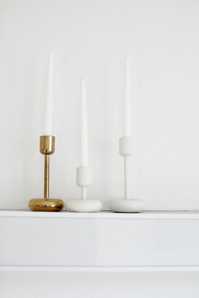 Iittala Nappula candleholders, white and brass. Via Varpunen.