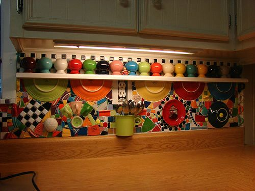Fiestaware kitchen backsplash by Carol West This is what I want to do to my backsplash but not use the big pieces, just smaller. But I do like the idea of the half cup to hold things.