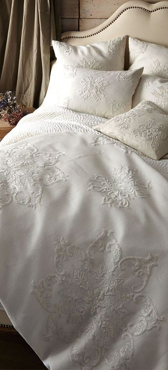 Lace linens.  Would look great w black throw and black, lilac pillows