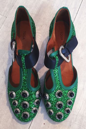 """Toga Pulla oga Pulla APRIL 22, 2016 """"Toga's runway shoes were so different than their signature western boots. These poison ivy green and kooky studding is not what you expect to see on fisherman sandals!"""""""