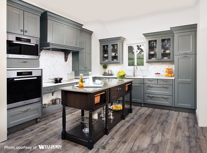 maple cabinets stained in a rich grey tone complemented by a charcoal stained cherry island