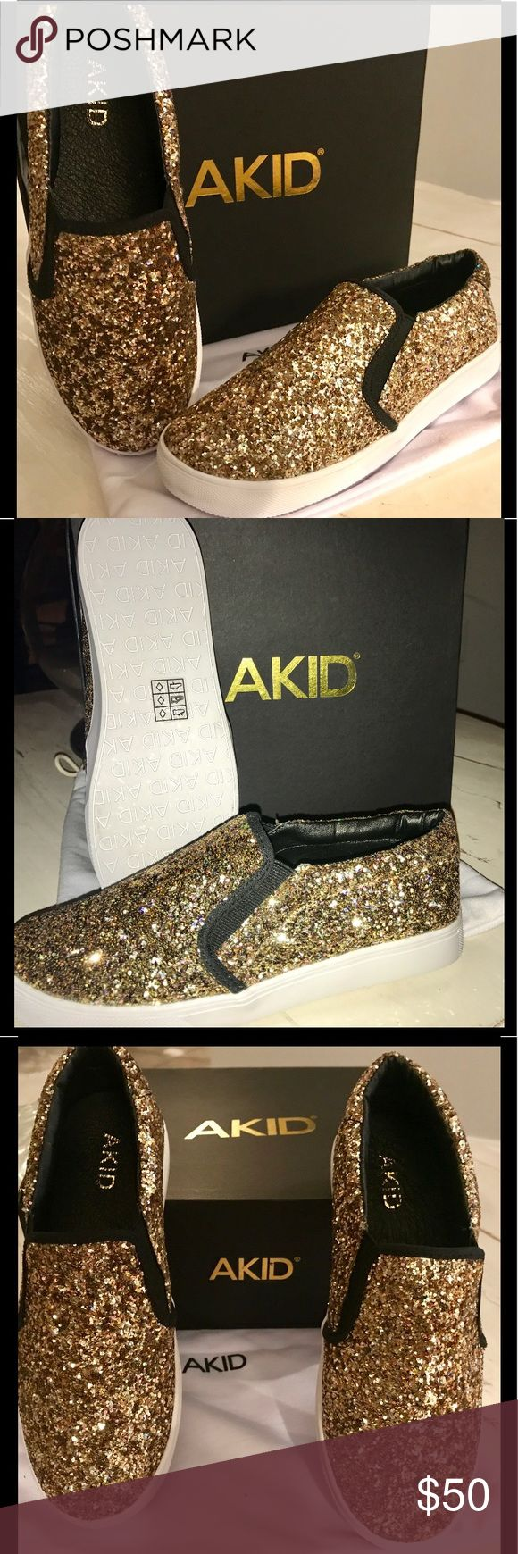 NWT ! AKID BRAND GOLD GLITTER SLIP ON TENNIS ! NWT. AKID TENNIS SHOE . In original box with dust bag.  Slip on tennis shoes !!! Perfect for a princess!!!!!  Blinged out!!!   Size 5 grade school !!!!! AKID Shoes Sneakers