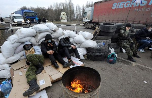 PHOTO: Crimean pro-Russian separatists blocking a road 28 February 2014 2