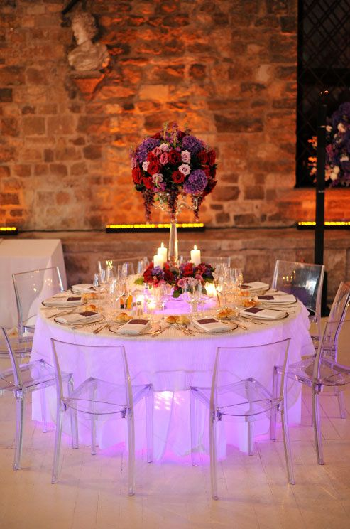 wedding table lighting. love the soft purple glow of this reception table create look with wedding lighting