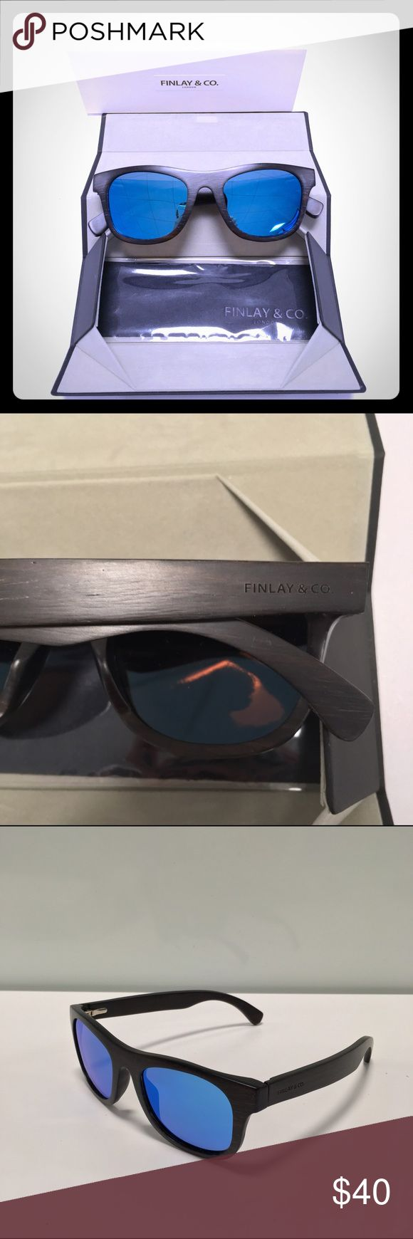 Finlay&Co Wooden Mirrored Wayfarer Sunglasses,50mm BRAND NEW. authentic women's Finlay & Co.'s of London 'Ledbury' wayferer sunglasses are handcrafted of brown lightweight ebony wood. Never before worn or used. Originally sold at Barney's New York and Blomingdales.  original retail price: $240 + tax color: wood/blue mirror.  Logo-etched temples. Round shape. Nose guards. Blue mirrored polarized lenses. 100% UVA/UVB protection. 50mm eye size. 22mm bridge size. 145mm temple size. Includes…