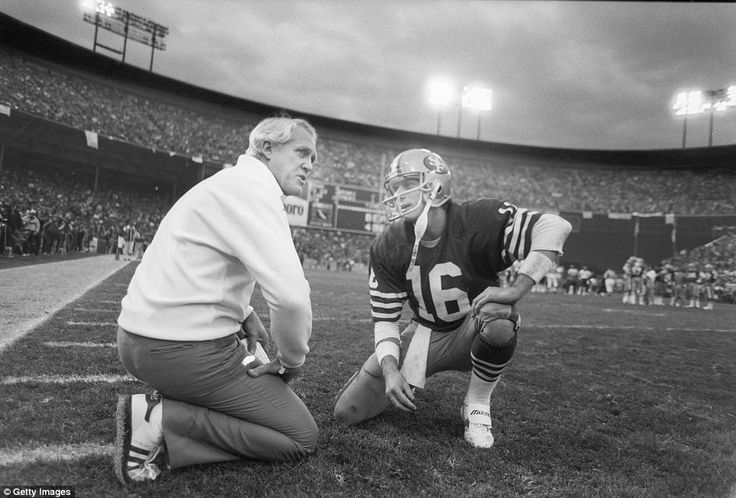 Montana (right) takes a knee to speak with Niners head coach Bill Walsh in the match against the Chicago Bears, which they won 23-0