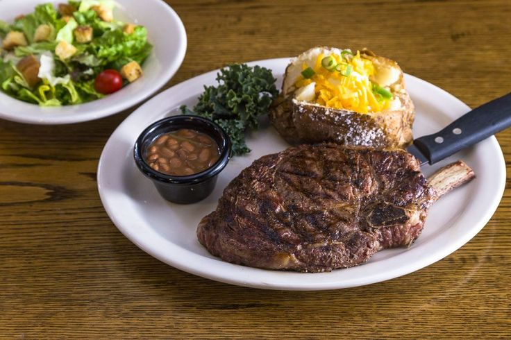 This is a picture perfect steak meal! It has everything, a well cooked steak, a baked potato with all the fixings, a salad, and even some baked beans. I don't know what else you would want! My husband would eat this up in the blink of an eye.