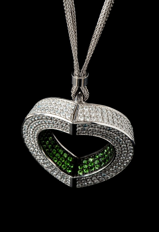 18ct white gold 'Hidden Heart' pendant set with diamonds and tsavorite garnets