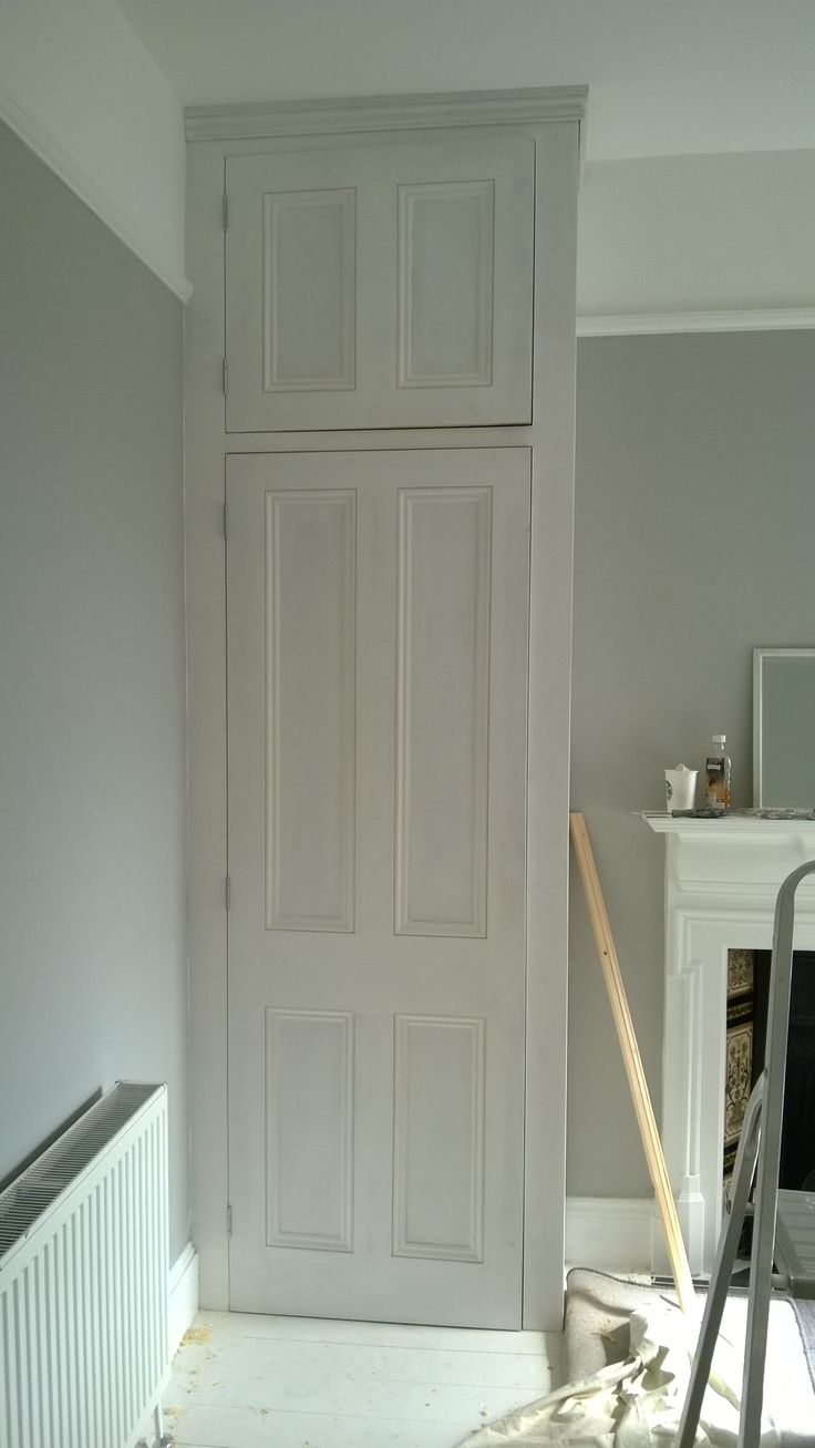 Victorian style alcove wardrobe with matching top cupboard.