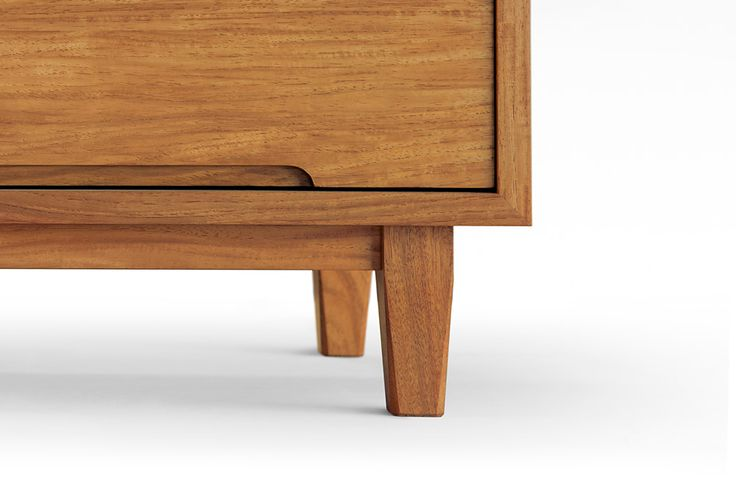 tapered legs with chamfered corners. nice drawer pull detail too