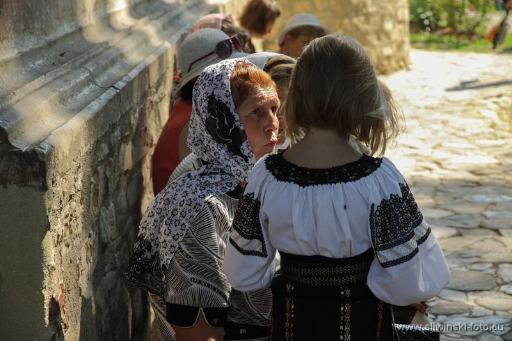 Woman and a child dressed traditionally. Romania.