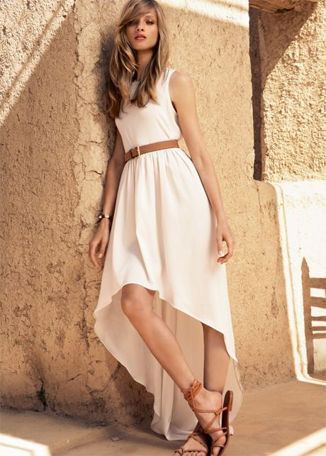 "The ""mullet"" dress is in this summer. Styled w/ gladiator sandals summerstyle"
