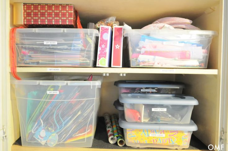 How Pioneer Woman organized her wrapping paper supplies into a small area.