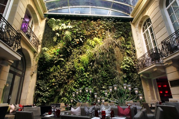 View of the 30-meter vertical garden (Vegetal Wall) in the courtyard of the Pershing Hall hotel in the 8th district of Paris designed by French Botanist Patrick Blanc.