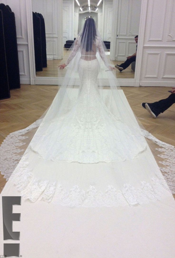 Kim's backless Givenchy dress was long-sleeved with a train, while a dramatic flowing white cathedral-length silk veil completed the look