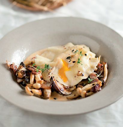 Duck egg ravioli with exotic mushroom sauce. The ravioli is made from scratch and served topped with exotic mushroom sauce and fresh thyme.