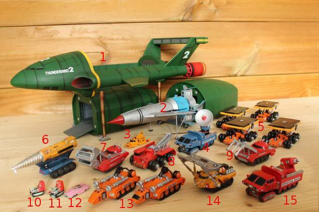 1. Thunderbird 2 (Supersonic carrier aircraft) - 2. Thunderbird 1 (Hypersonic rocket plane) - 3. Thunderbird 4 (Utility submersible) - 4. Transmitter truck - 5. Elevetor Cars - 6. The Mole - 7. Excavator - 8. Mobile crane - 9. The DOMO (Demolition and Object Moving Operator) - 10. Laser cutter vehicle - 11. Thunderiser -12. Lady Penelope's FAB 1 - 13. Recovery Vehicles - 14. Firefly - 15. Fire truck - Serie Thunderbirds. https://www.youtube.com/watch?v=D_mBUaPsX6o