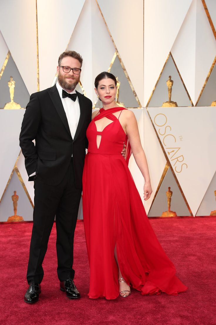 Seth Rogen and Lauren Miller arrive on the Oscars red carpet for the 89th Academy Awards.