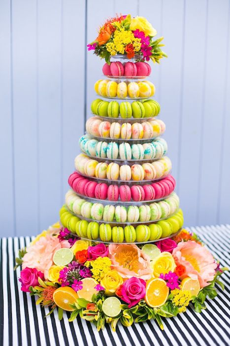 A tower of macarons in tropical colors is a gorgeous cake alternative. Source: Bridal Musings #macarons #tropics See more...@intimatewedding