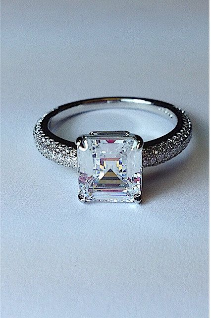 Asscher Cut Engagement Ring by MPPARAGONDESIGN on Etsy- I know it's not princess cut but this ring is darling.