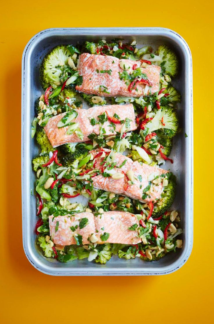 Enjoy an easy, healthy dinner with this simple one-tin salmon and broccoli recipe from The Roasting Tin. Served with a lip-smacking ginger, lime and peanut dressing, this dish is bound to become one of your midweek favourites.