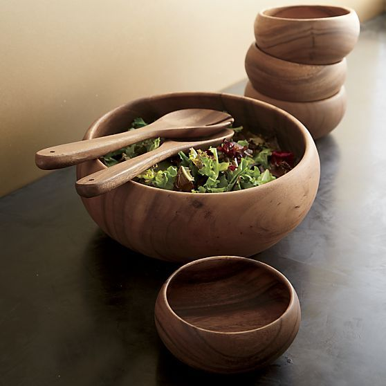 Richly grained acacia wood turns out in smooth, sculptural serving essentials, naturally suited to everyday use, entertaining or artful display. Bowls round in organic curves to hold salads, snacks, fruit or collectibles. Each piece is given a clear lacquer finish to bring out the wood's warm color and individual markings. Harvested from well-managed forests in the Philippines under close supervision of the local government's reforestation program.