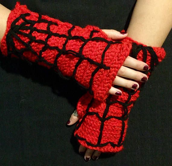 Spin a web of any size with your fingers free with these awesome hand crocheted Spiderman fingerless gloves! Crocheted in a mix of a lighter and a darker shade of red to show the highlights and shadows of the Spiderman suit. The hand sewn web details are done in black. The Spiderman fingerless gloves are great to add to an easy cosplay or just wear in real life to show your love of comics. My fingerless gloves are unisex. They are 10 inches long and about 10 inches around. They are the…