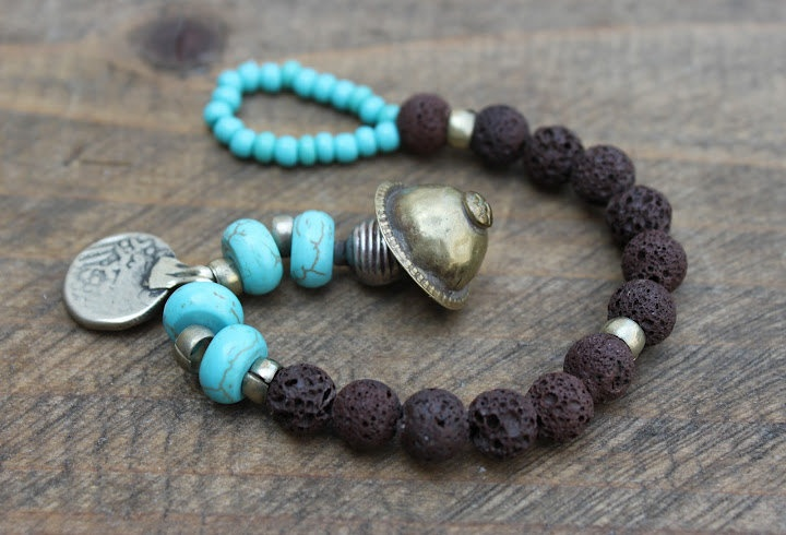Elastic ethnic beads bracelet inTurquoise and Brown Lava beads/eclectic/nomadic/hippie/flea market finds /Boho chic /one of a kind. $26.00, via Etsy.