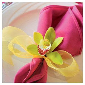 A great example of how a little ribbon and a stunning bloom can completely transform a basic napkin into something special.  Take this concept – change the colors, change the ribbon and the flower – and make it your own.