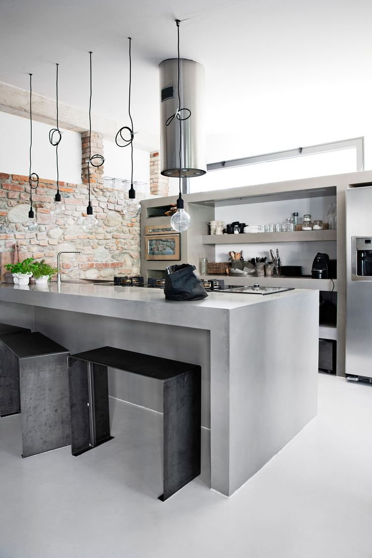 <p>Located only a half hour from Milan, the newly restored home of fashion designer Monica Rusconi features brick walls, old beams, and lots of natural wood. The combination of white, concrete, and bl