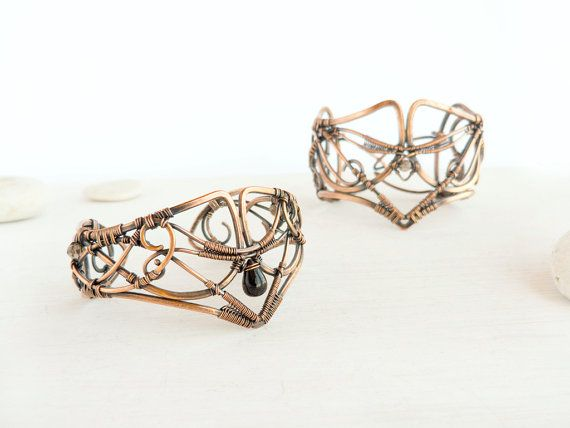 """Minstrelsy"" pair of copper bracelets by Oksana Truhan"